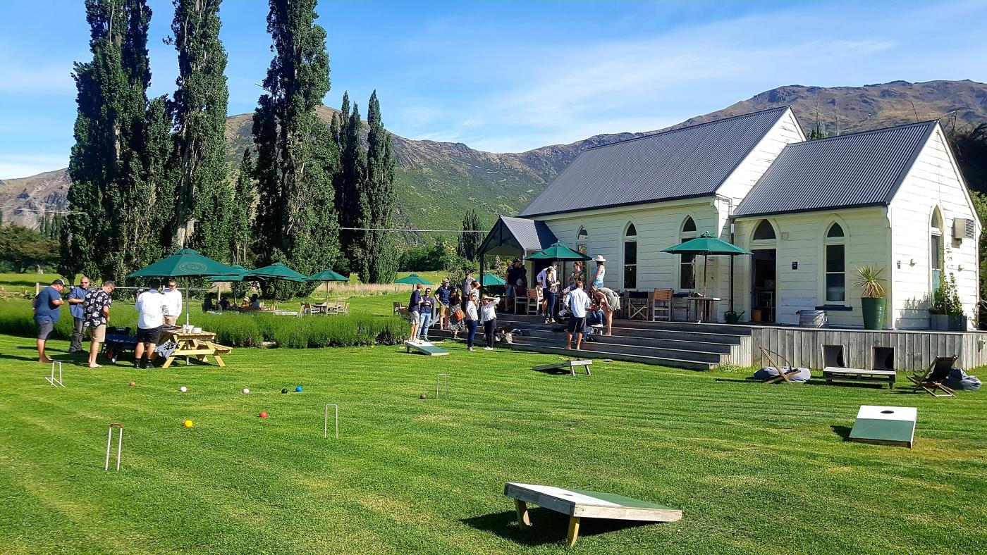 Outdoor dining and lawn games at Cargo Brewery Waitiri Creek