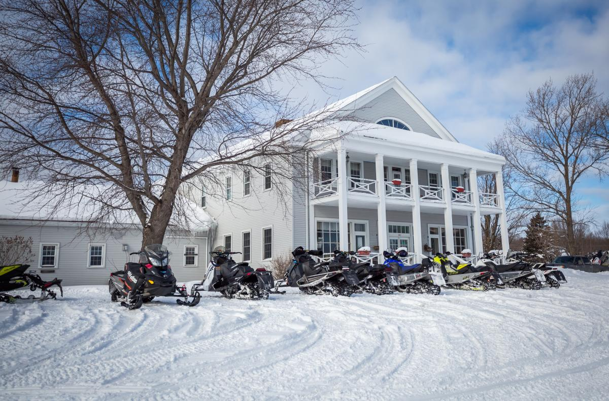 Snowmobiles lined up outside of Thunder Bay Inn in Big Bay, MI