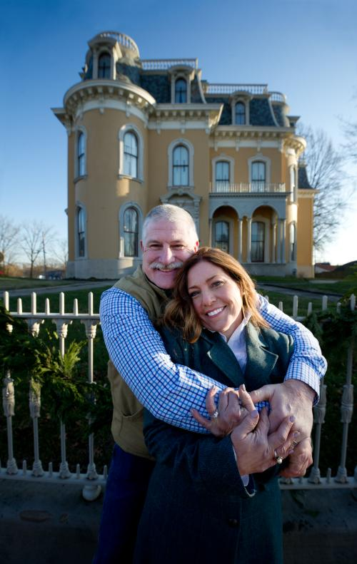 Couple in a hugging pose in front of Culbertson Mansion