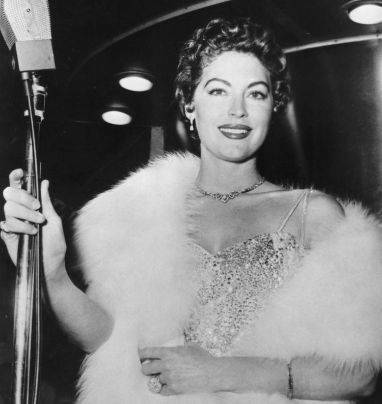 Black and White Photo of Ava Gardner in Fur with Mic
