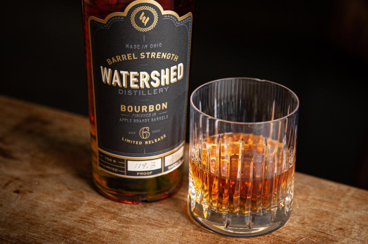 Watershed Barrel Strength Bourbon Next To A Glass