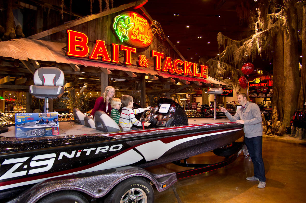 Family playing in boat at Bass Pro Shops
