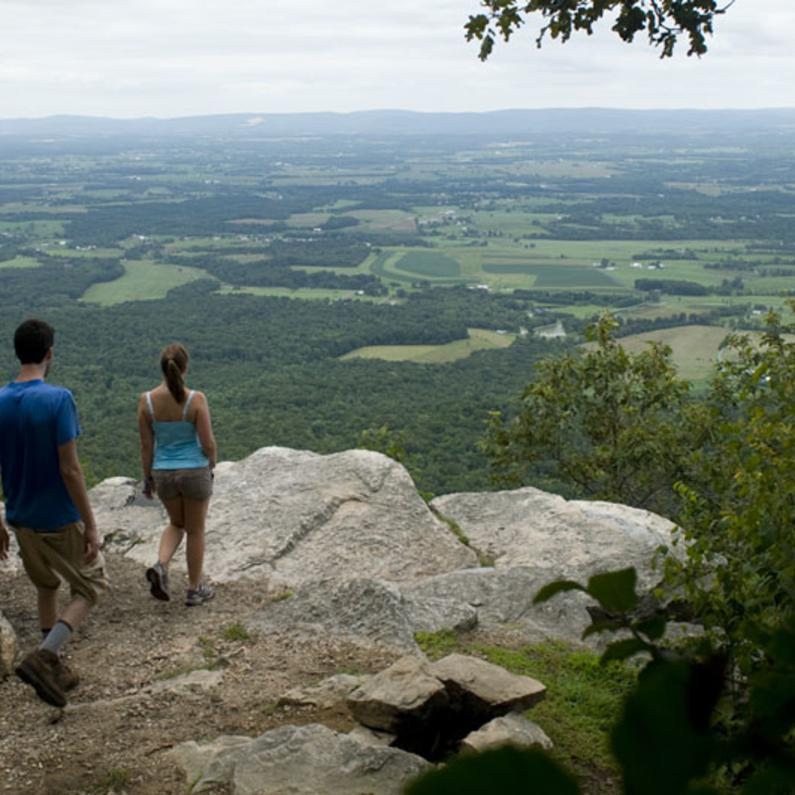 Couple overlooking rock edge at the Colonel Denning State Park