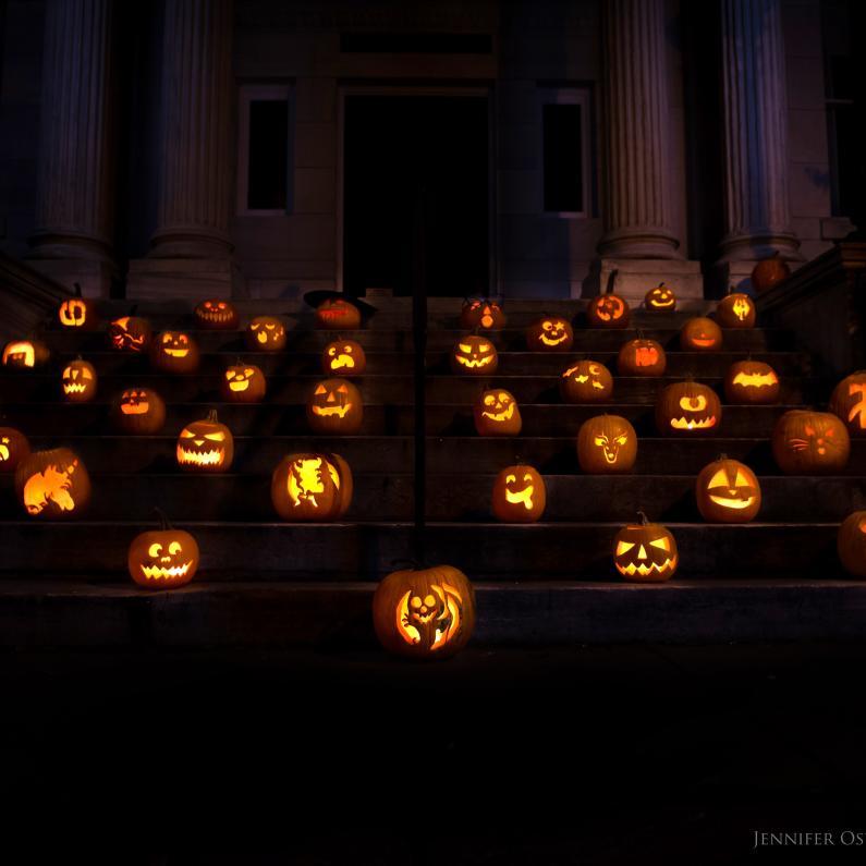 Jack-o-lanterns glowing at Destination Carlisle Halloweekend