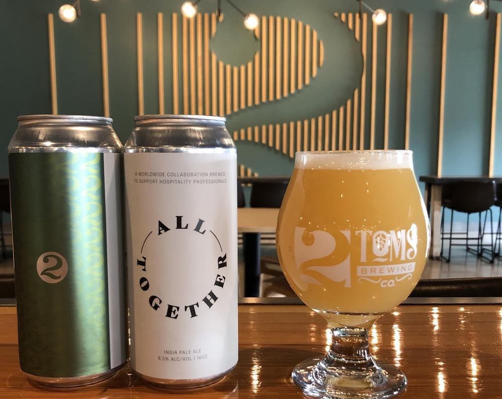 Two cans and a glass of the All Together IPA from 2Toms Brewing Company in Fort Wayne