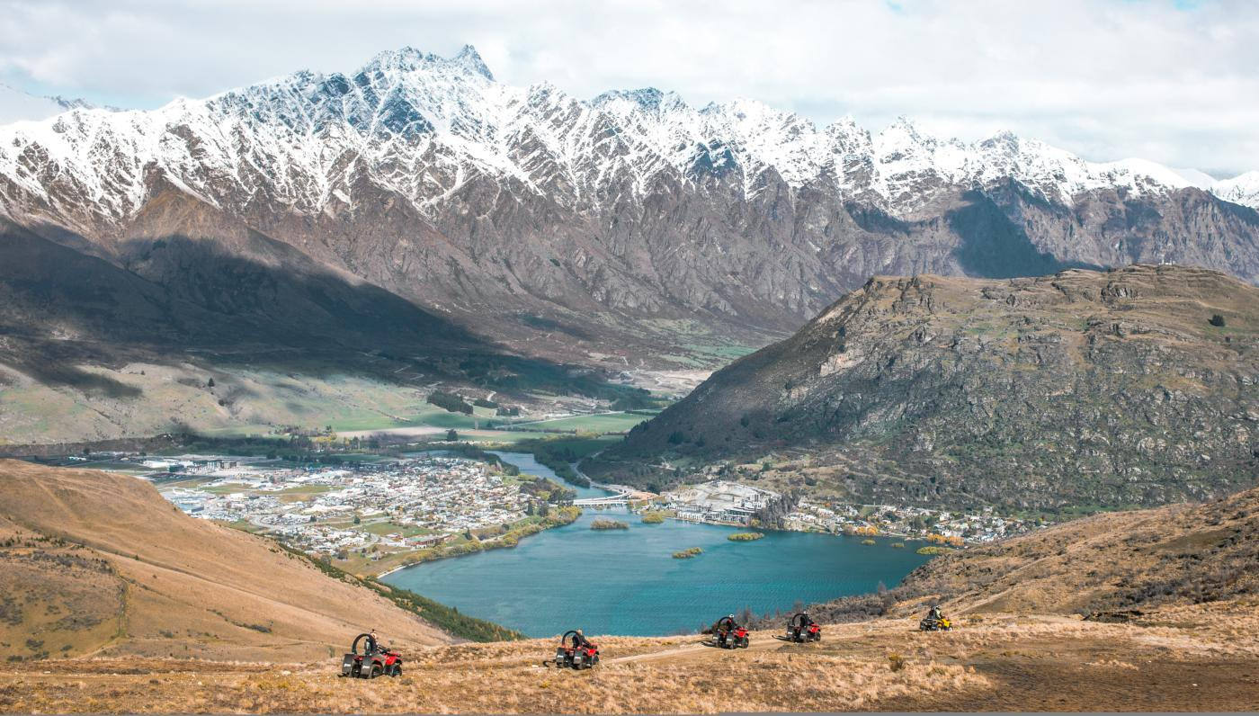 Nomad Safaris Quad Bike Tour on Queenstown Hill, with Lake and Remarkables in the background