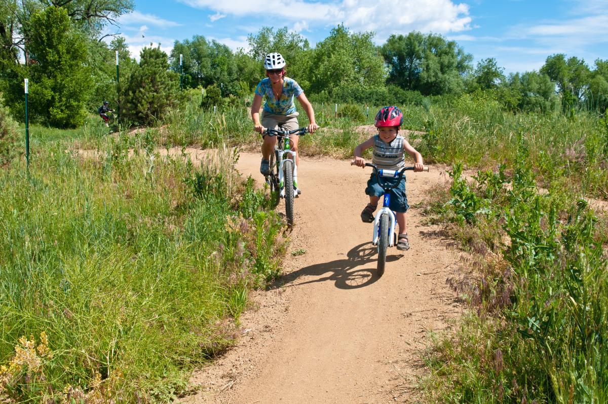Man And Child Biking On A Valmont Bike Trail
