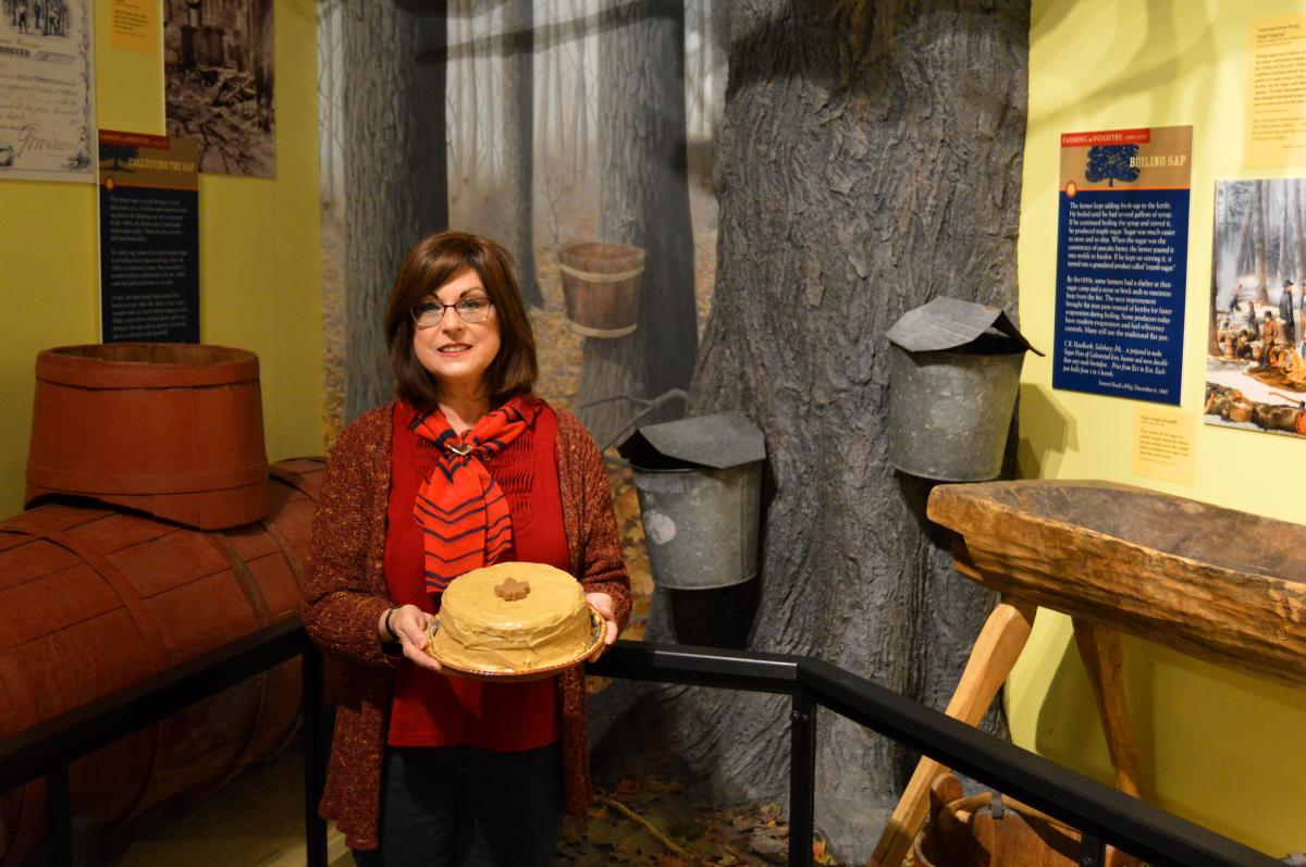 Woman holding a burnt sugar cake