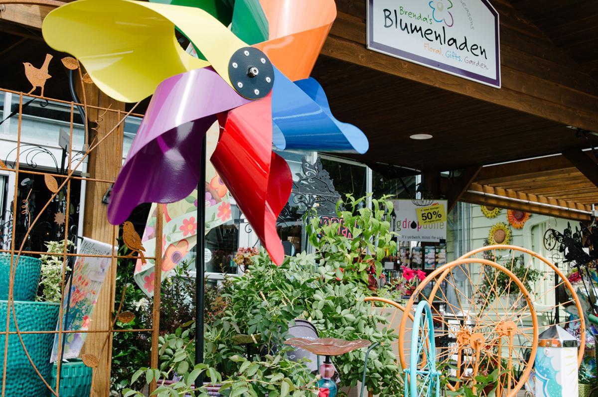 A pinwheel and flowers line Brenda's Blumenladen storefront