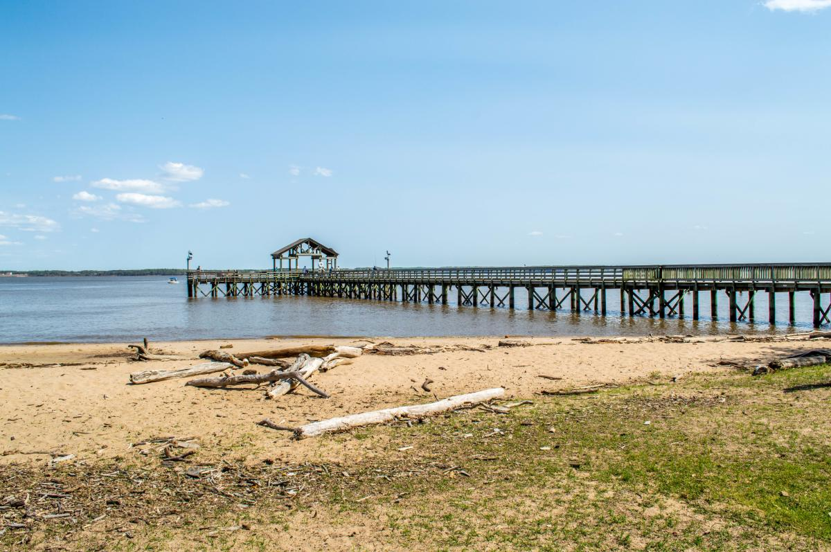 view of the fishing pier and water from the sandy beaches of Leesylvania State Park