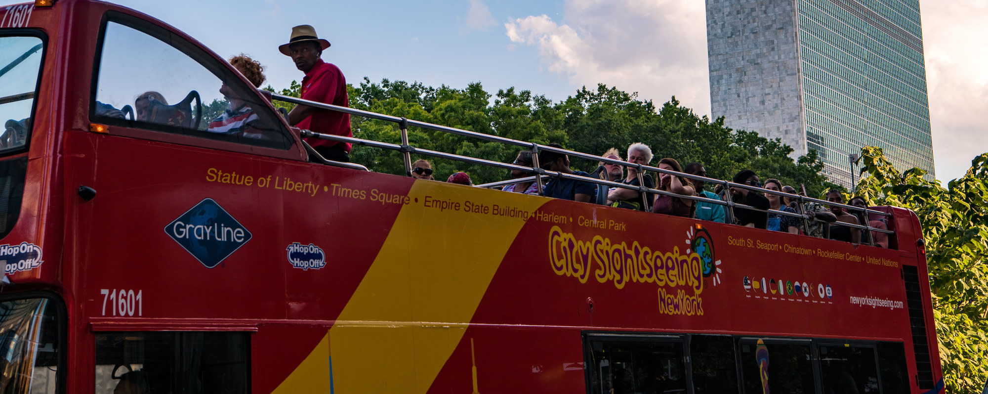 A picture of people on the top of a double-decker bus on the Grey Line Sightseeing Tour NYC