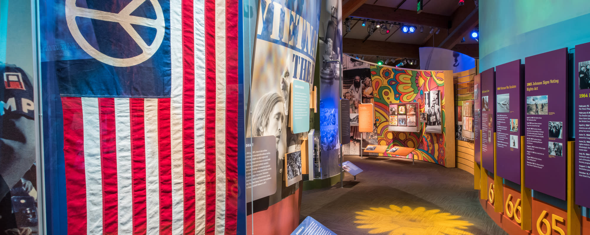 A look at the inside of the Museum at Bethel Woods displays and American flag with peace sign