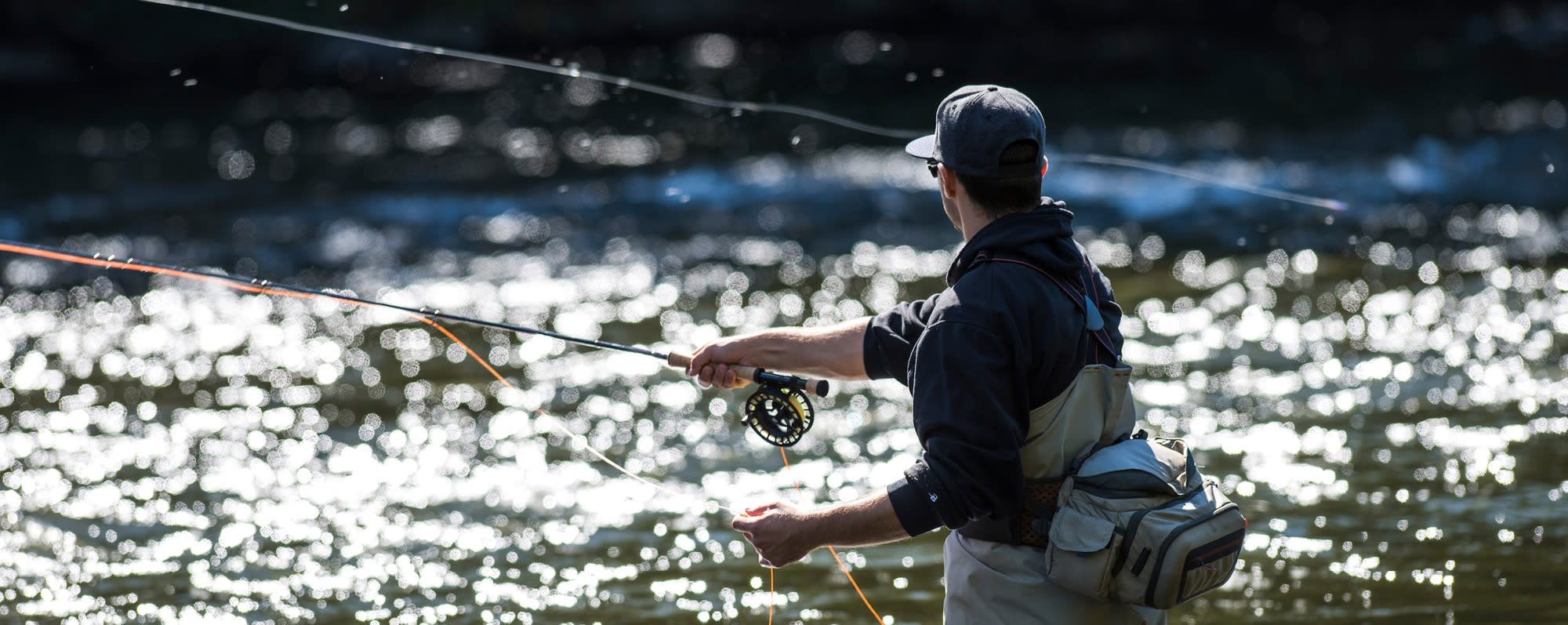 A man fly fishing in the Salmon River in Pulaski