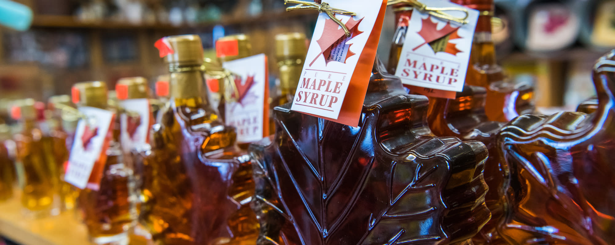A photo of maple leaf shaped maple bottles at Shaver Hill Maple Farm