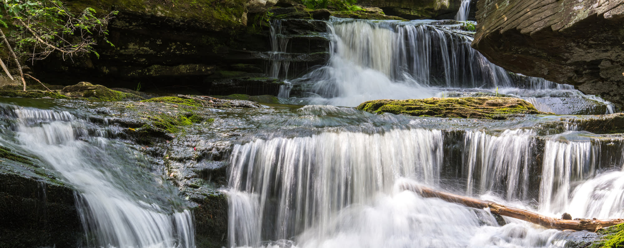 A photo of water cascading down Vernooy Kill Falls