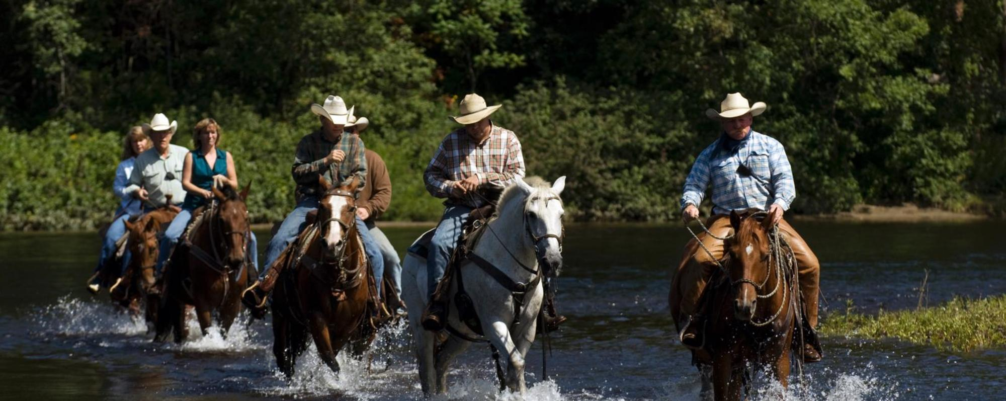Trail ride through pond at 1000 Acres Ranch (formerly Stony Creek Ranch Resort)