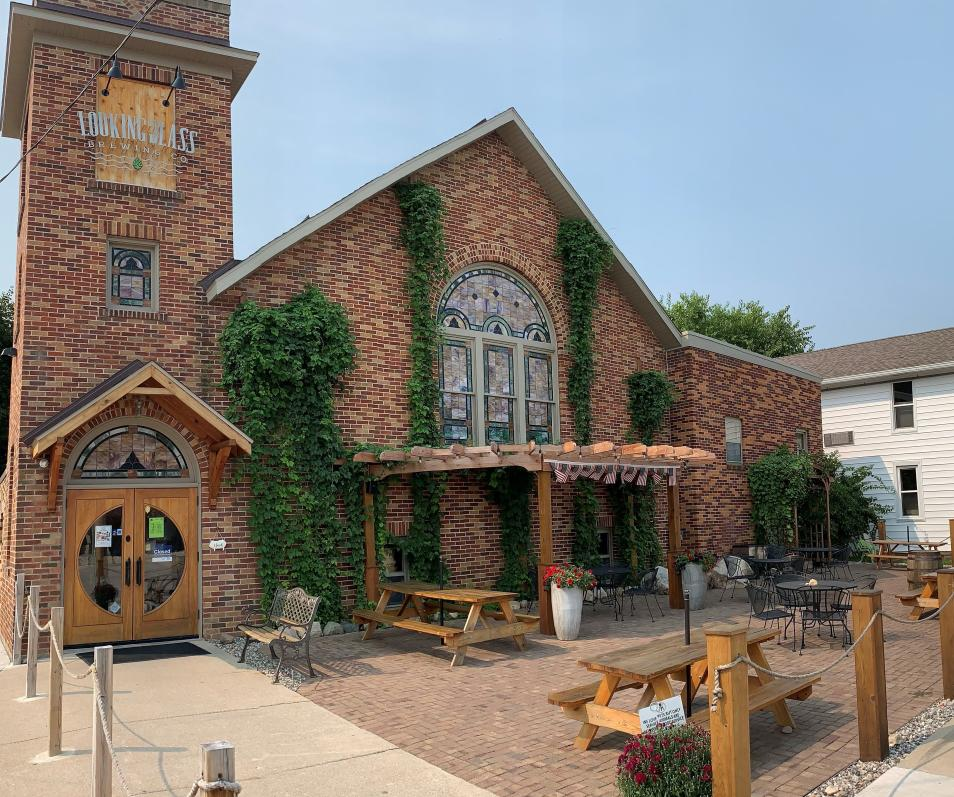 Patio of brewery with picnic tables and tables and chairs