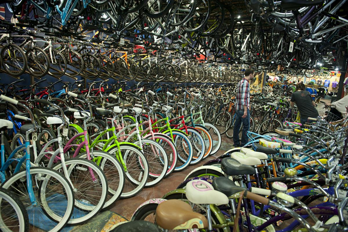 Man Walking Among Hundreds Of Bikes At University Bicycles Boulder