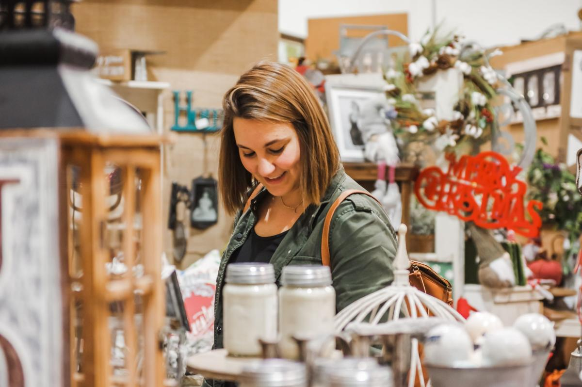 Woman shopping amid holiday decore