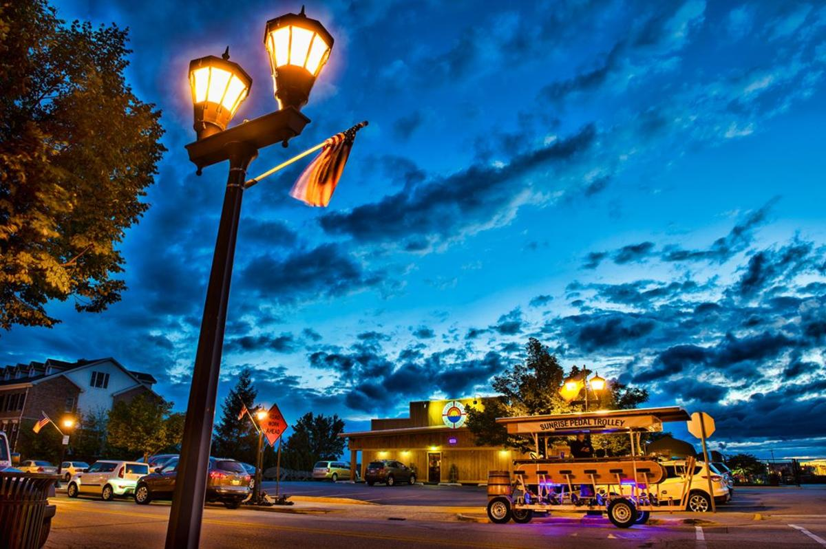 Sunrise Pedal Trolley in Bay City lit up with a colorful evening sky as the backdrop