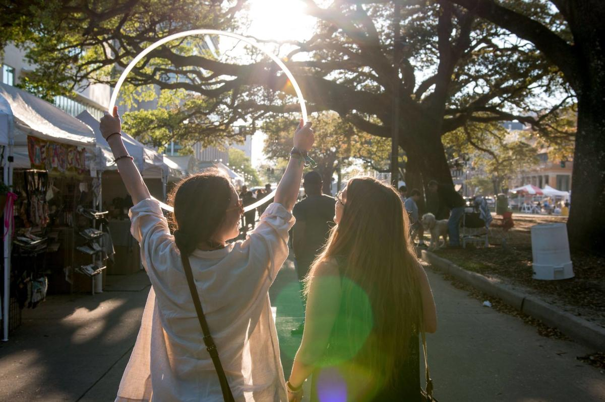 Festival-goers prepare for a fun day of music and community at a Baton Rouge music festival.