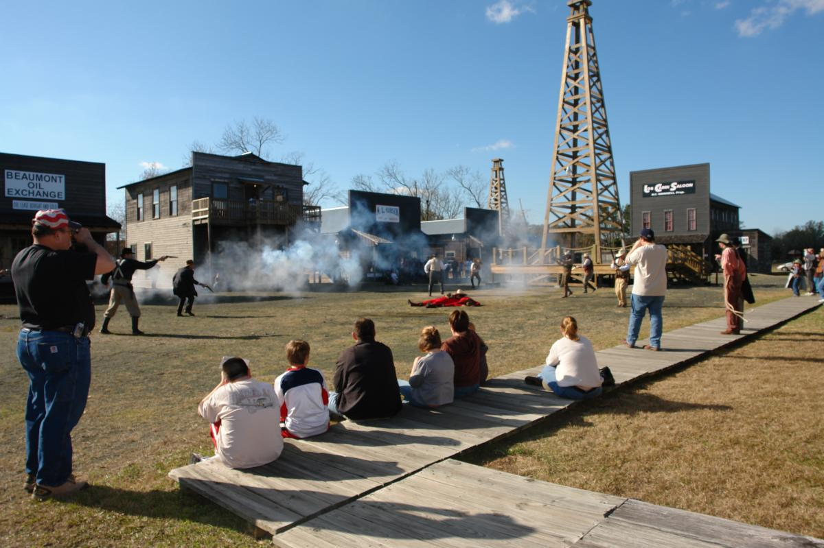 Spindletop history as actors portray a shootout at the anniversary celebration.
