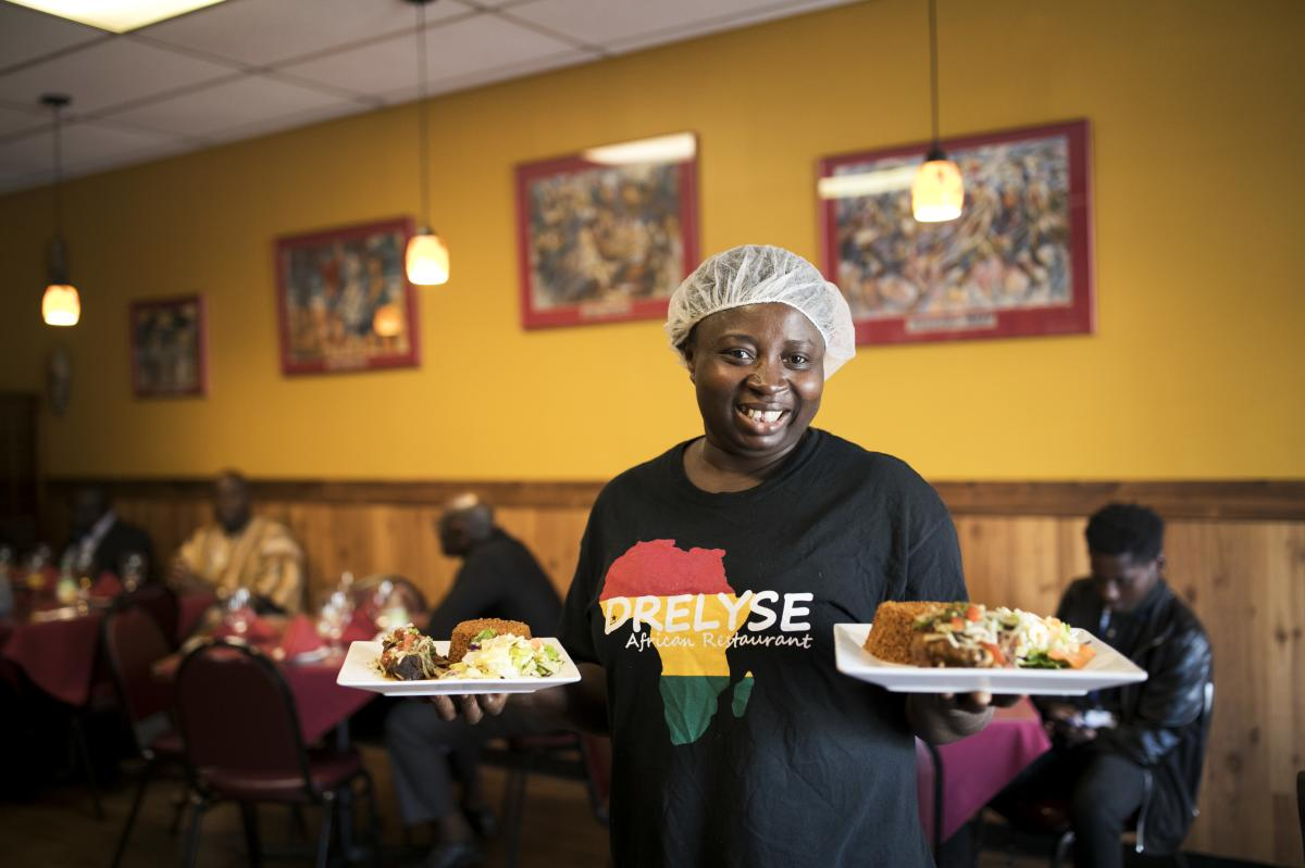 Serving food at Dreylse Africa Restaurant