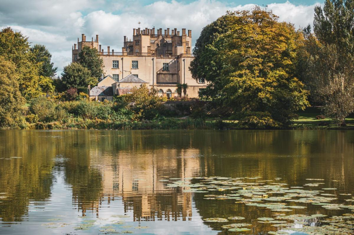 Looking over a large pond to Sherborne Castle