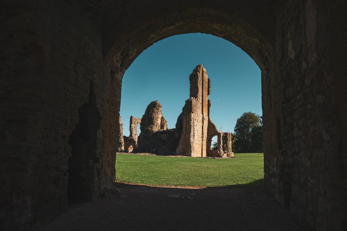 Looking through a walk way to the ruins of Sherborne Old Castle