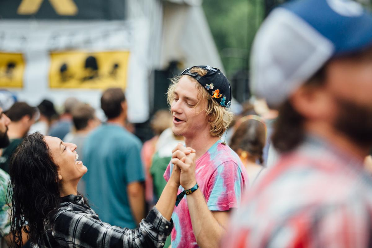 Couple dancing hand in hand at Blue Ox Music Festival