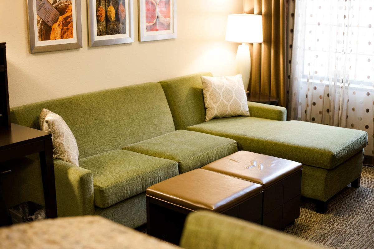 Couch in room at Staybridge Suites in Altoona, WI