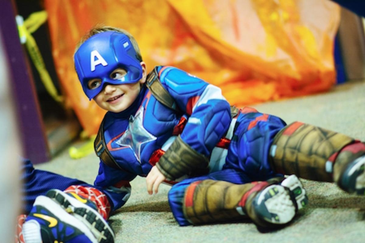 Child dressed in Captain America Halloween Costume