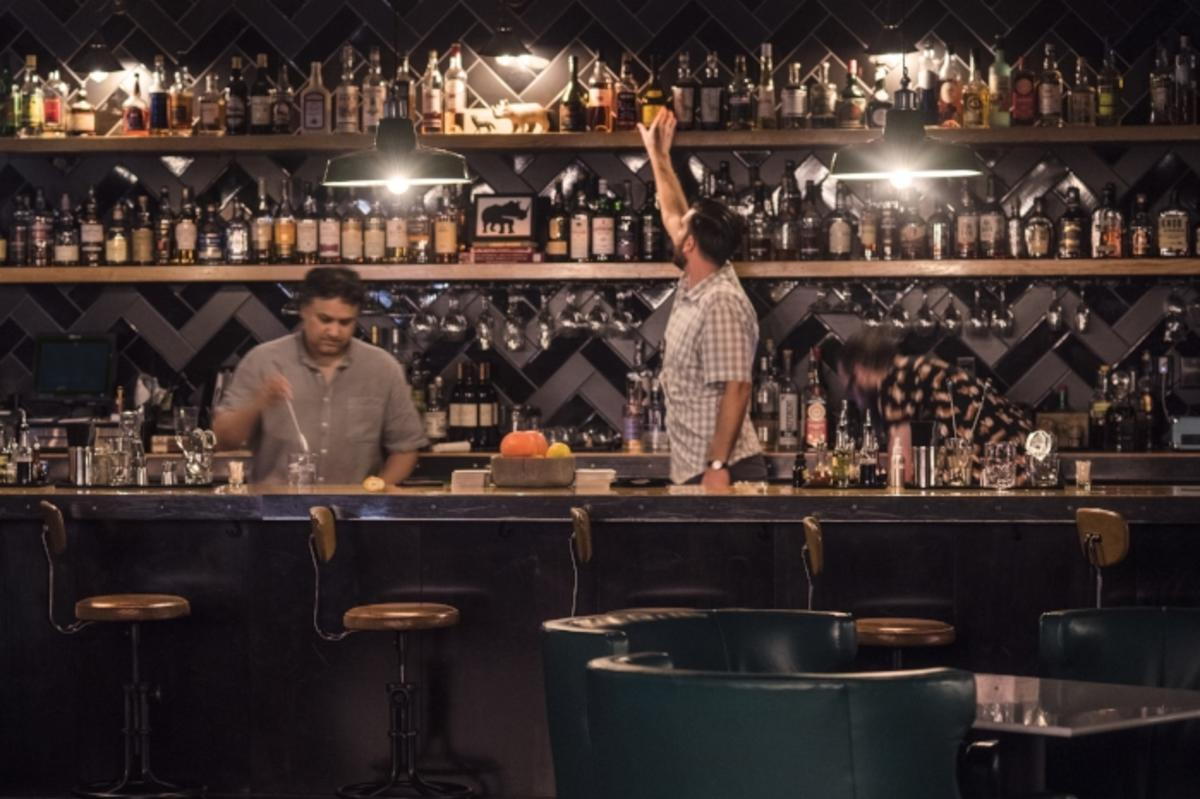 Bartenders making drinks at the Dive Bar located at the Lismore Hotel in downtown Eau Claire