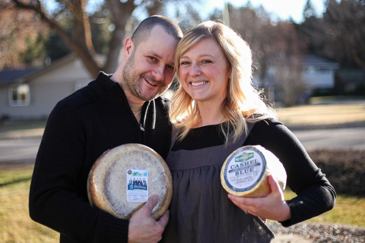 Perseval & Young Cheesemongers - Owners holding wheels of cheese
