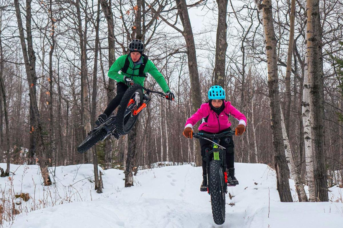 Pat and Hannah Smage fat biking on the trails in Marquette, MI
