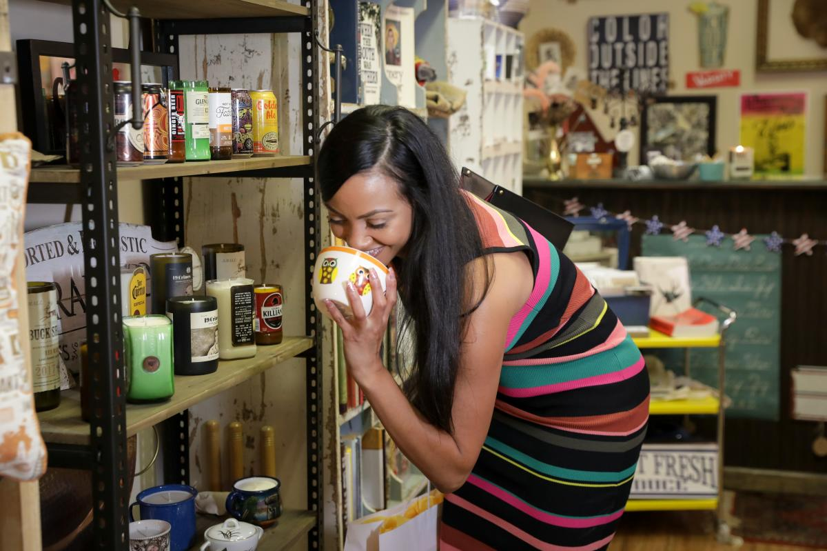 Woman smells candle at Market Collective