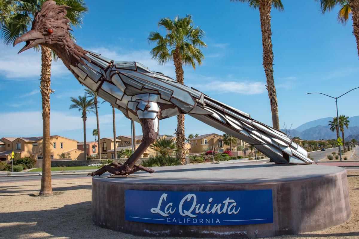 Roadrunner sculpture, blue skies