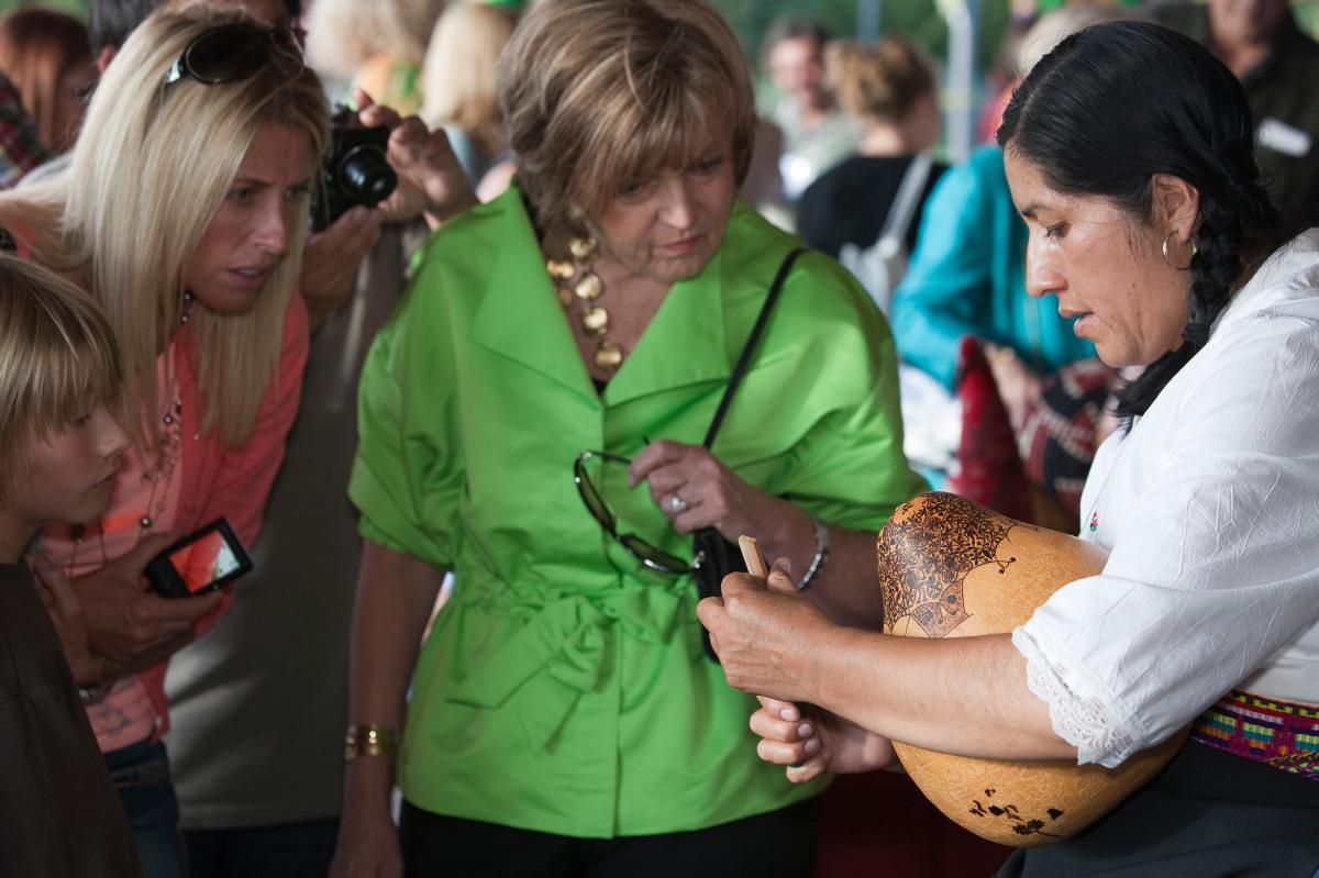 Demonstrating Peruvian gourd carving at International Folk Art Market  Shown