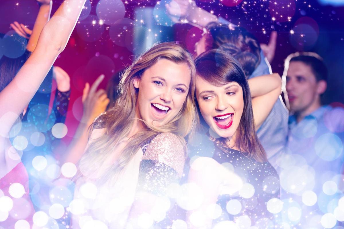 Girls dancing in club atmosphere