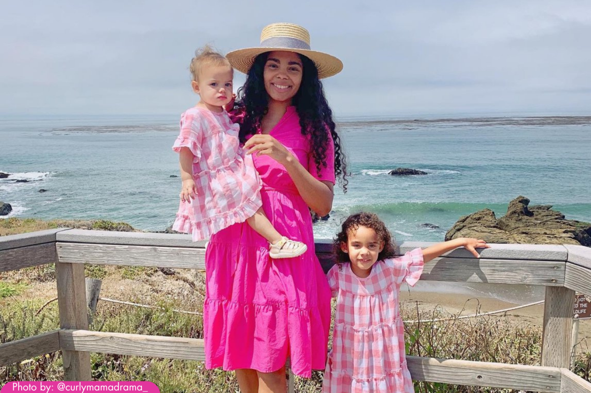 Mother and daughters standing by the ocean at Cambria