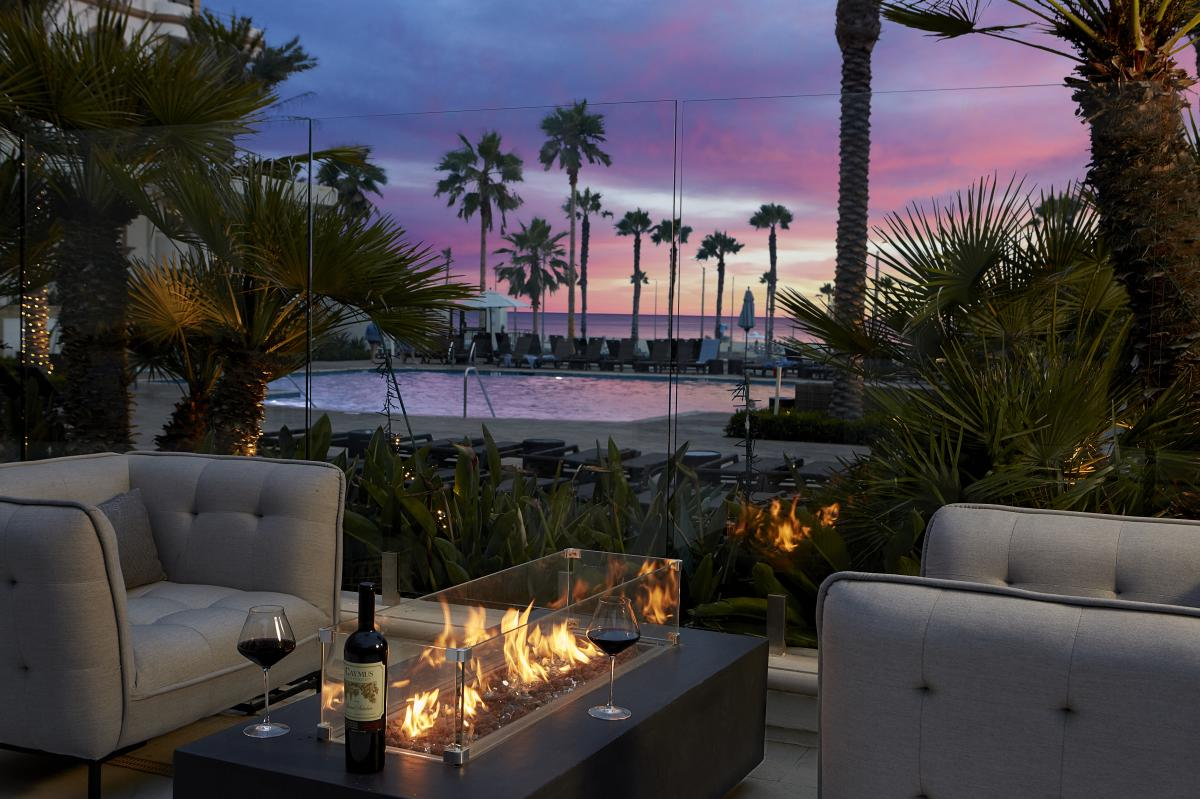 View of a pool and the ocean from Henry's Uncorked Wine Bar in Huntington Beach