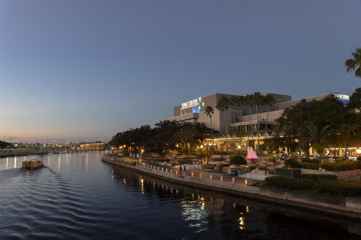 The Straz Center for Performing Arts as viewed from a nearby bridge overlooking the Pirate Water Taxi crossing by on the adjacent Hillsborough River.