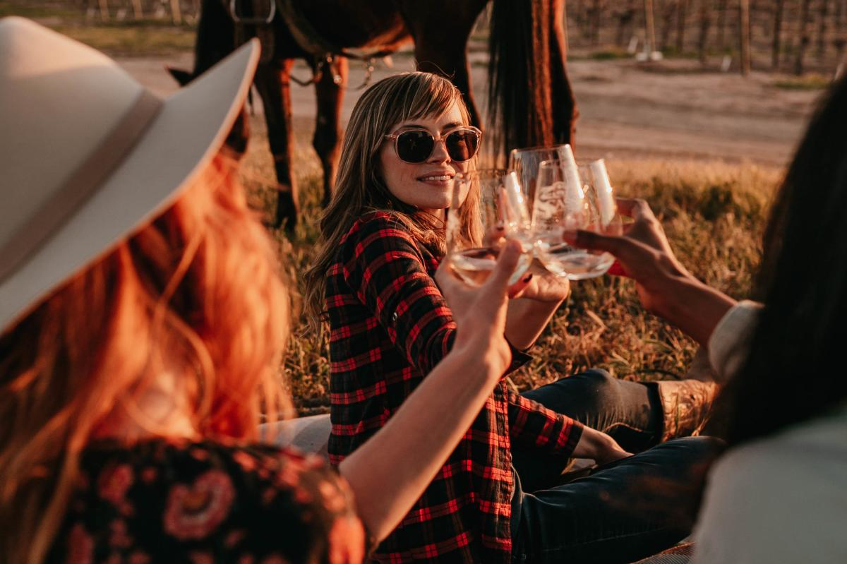 Girls Cheers WIth Paso Wine After a Horseback Ride