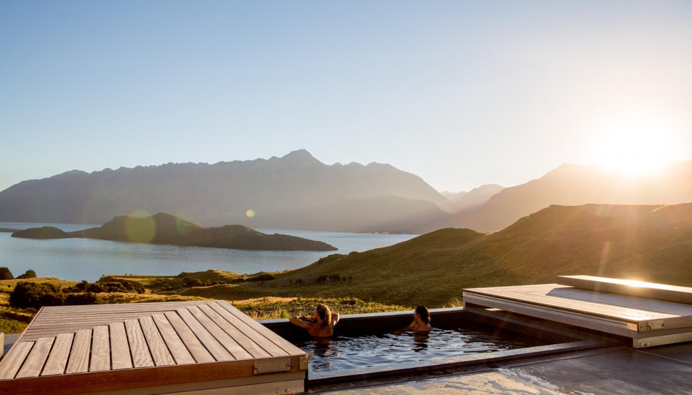Two women relaxing in the outdoor spa at Aro Ha Wellness Retreat