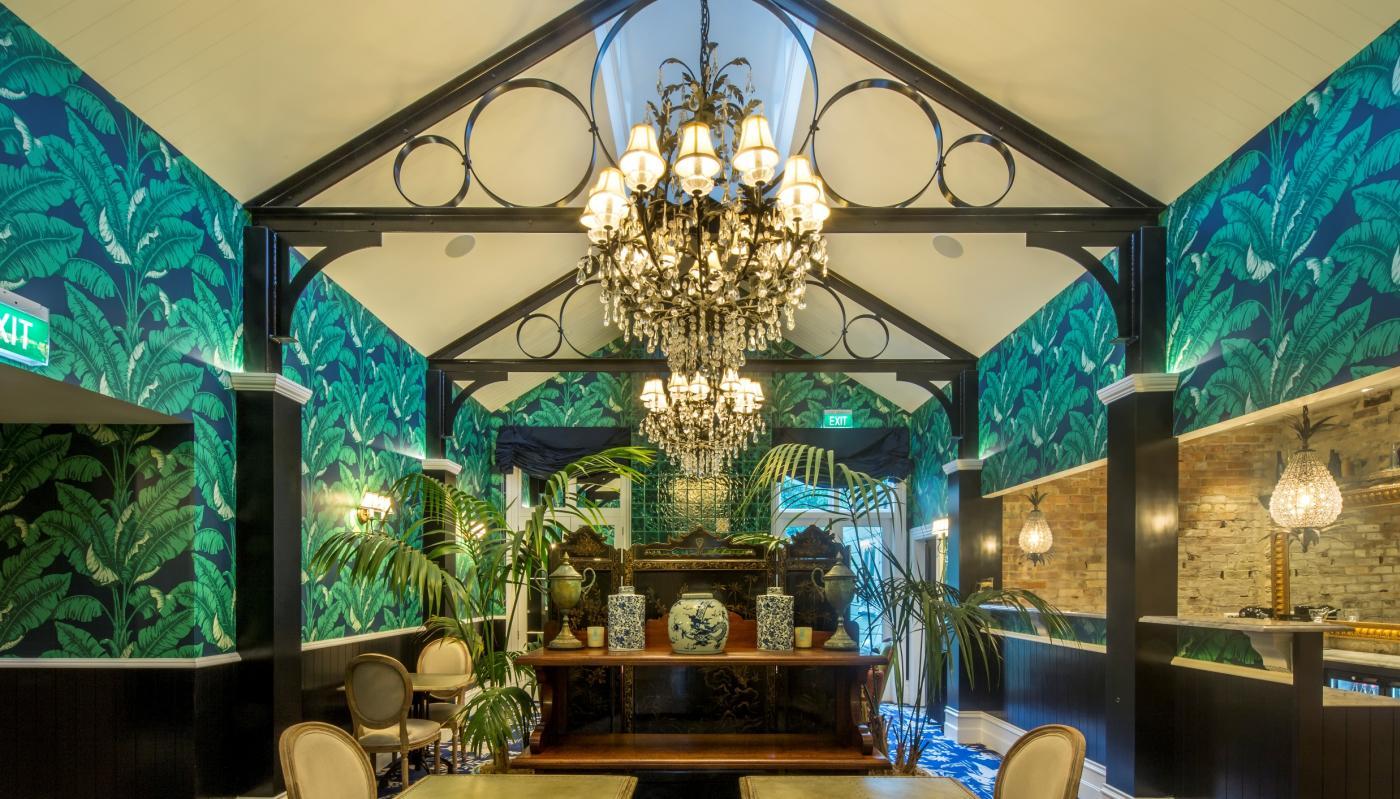 Hulbert House lounge with palm tree decor