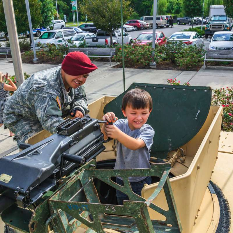 American Soldier enjoying child's reaction at National Airborne Day event