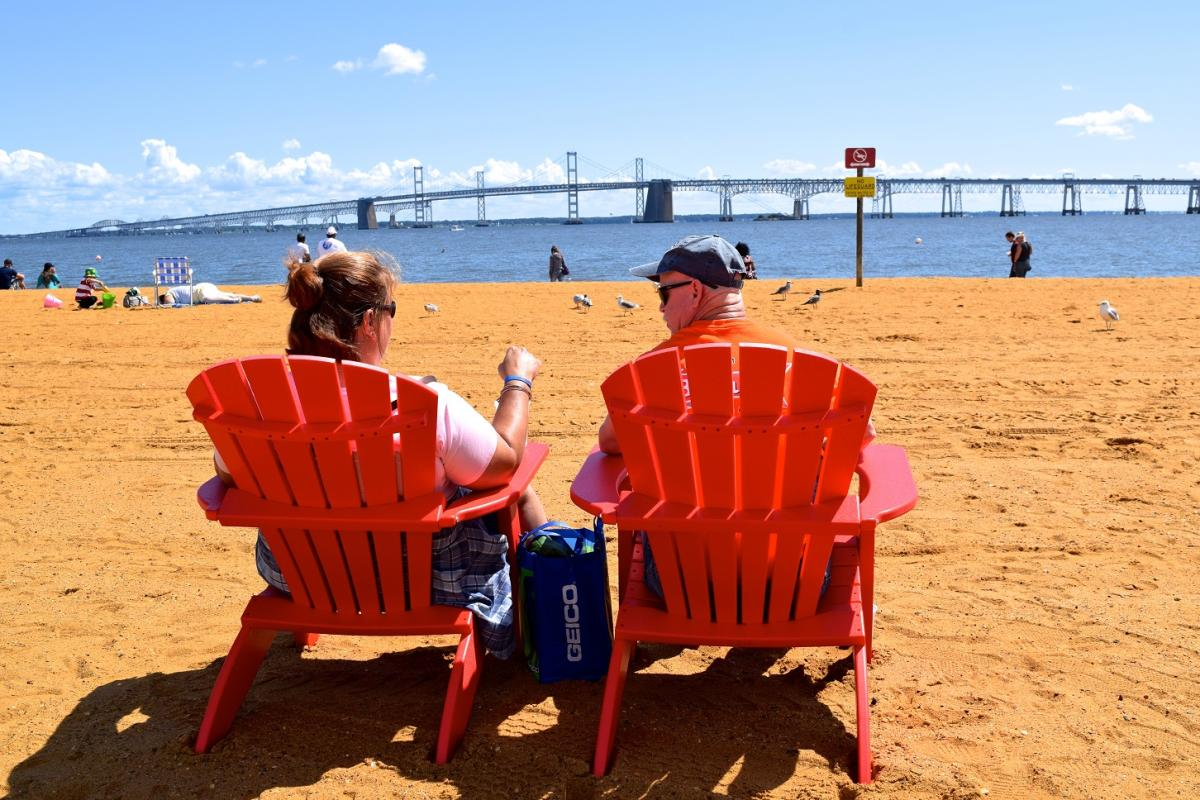 Couple in Adirondack Chairs on Beach