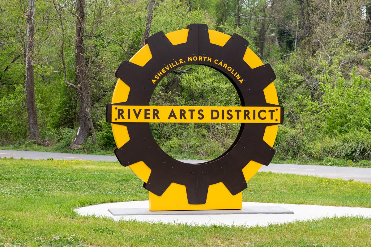 A sign welcomes visitors to the greenway in Asheville's River Arts District