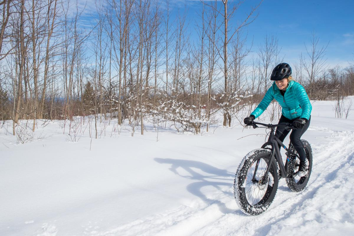 Woman Fat Biking in the snow in Boulder, Coloardo