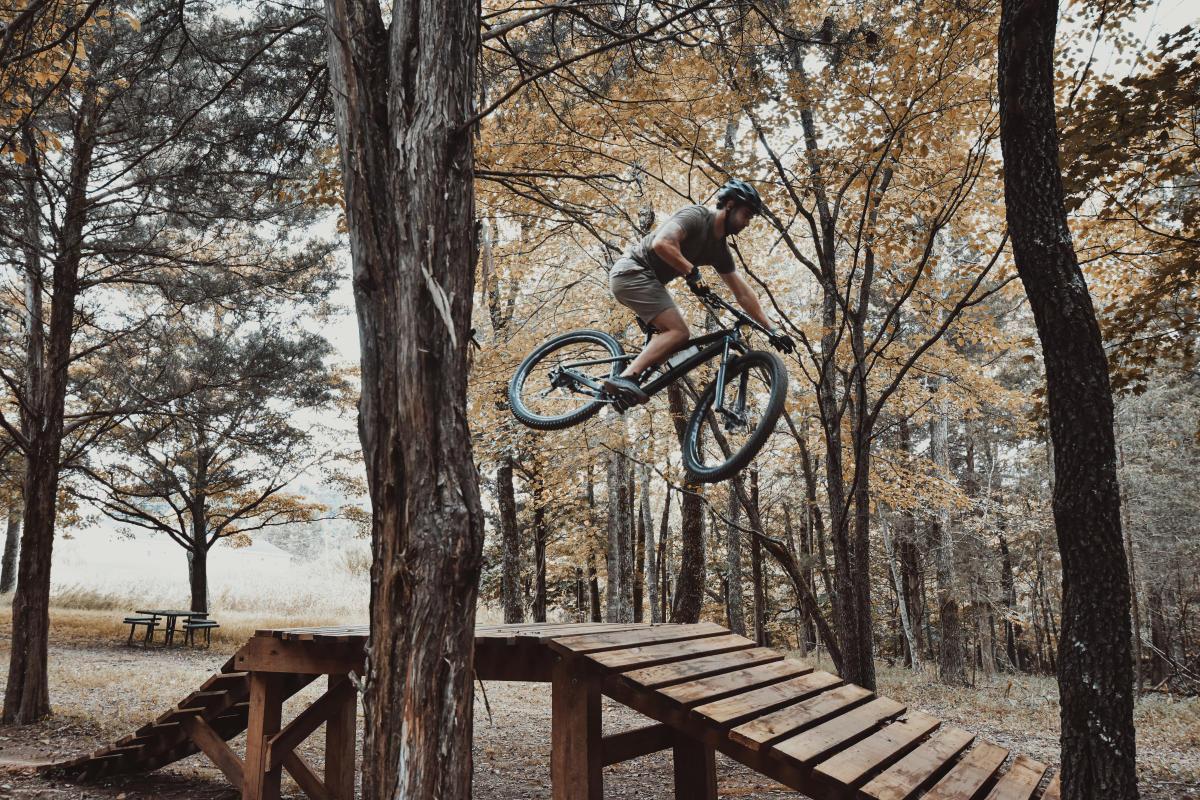 mountain biker going over a jump